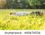 a handsome young man relaxing... | Shutterstock . vector #440676526