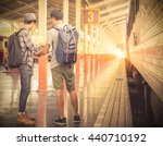 tourists  standing with map.... | Shutterstock . vector #440710192