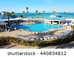 Small photo of Melia Nassau Beach Resort, Bahamas - 10th of April, 2016: Several families enjoy their holidays in the swimming pool of this all-inclusive resort, placed close to a caribbean beach in Nassau.