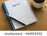 Agenda Written On Notebook Wit...
