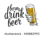 male hand holding a beer glass. ...   Shutterstock .eps vector #440882992
