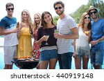 group of friends holding a... | Shutterstock . vector #440919148