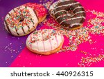donuts on color background. | Shutterstock . vector #440926315