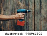 Electric Screwdriver In Hand A...
