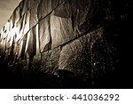 Dark Stone Wall Shining With...