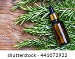 rosemary oil bottle on wood... | Shutterstock . vector #441072922