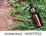 rosemary oil bottle on wood... | Shutterstock . vector #441072922
