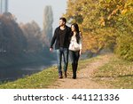 couple walking in forest... | Shutterstock . vector #441121336