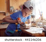 child whittling a  carpenter's... | Shutterstock . vector #441146206