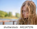 young girl in a top and shorts... | Shutterstock . vector #441147196