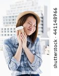 young woman holding disposable... | Shutterstock . vector #441148966