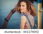 young lovely woman on the bridge | Shutterstock . vector #441174052