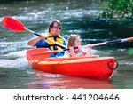 Family On Kayaks And Canoe Tou...