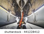 Small photo of airplane landing gear detail view