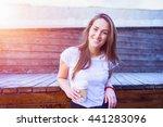 smiley woman drinking coffee... | Shutterstock . vector #441283096
