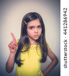 Small photo of Young girl with brown hair acts in studio.
