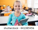 a cute pupil posing with tablet ... | Shutterstock . vector #441385456