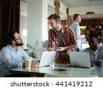 men working in office in... | Shutterstock . vector #441419212