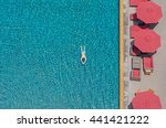 a man swim in the pool at the... | Shutterstock . vector #441421222