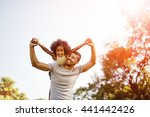 father carrying daughter... | Shutterstock . vector #441442426