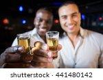 handsome men drinking together... | Shutterstock . vector #441480142