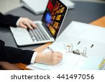 women working on a desk with a... | Shutterstock . vector #441497056