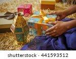 a young  girl receiving a gift. ...   Shutterstock . vector #441593512