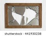 Broken Mirror On White Wooden