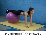 Young Happy Woman Training In...