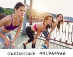 three sportive pretty women... | Shutterstock . vector #441964966