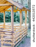 Small photo of Wooden alcove in the forest park in summer time