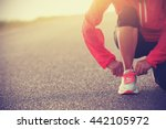 young woman runner tying... | Shutterstock . vector #442105972