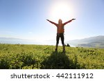 cheering young woman backpacker ... | Shutterstock . vector #442111912