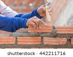 bricklayer working in...