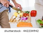 mid section of man chopping... | Shutterstock . vector #442234942