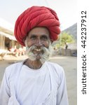 Small photo of KANAKOLAR, INDIA-MARCH 03: a rural man of rebari costom wearing colorful turban and casual and agree to pose at annual festival of rebari people comunity on March 03, 2016 kanakolar, Rajasthan, india