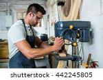 carpenter using a drill in his... | Shutterstock . vector #442245805