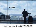 Traveler In Airport Looking At...