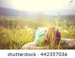 carefree happy man lying on... | Shutterstock . vector #442357036