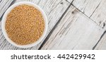 yellow mustard seed in white... | Shutterstock . vector #442429942