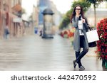 urban  woman with shopping bags ... | Shutterstock . vector #442470592