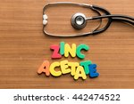 Small photo of zinc acetate colorful word with stethoscope on wooden background