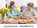 Caregiver And A Senior Lady...