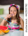 girl drinking lemonade  in... | Shutterstock . vector #442505782