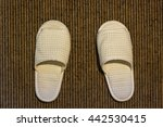 white slippers on weave mat | Shutterstock . vector #442530415