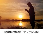 silhouette of man praying... | Shutterstock . vector #442749082