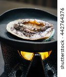 Small photo of Fresh Abalone Grilling on a Stove. Selective Focus.