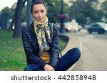 Girl Sitting On A City Street....