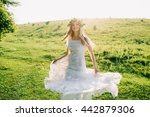 young girl in a white dress in... | Shutterstock . vector #442879306