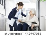 physiotherapist consoling... | Shutterstock . vector #442947058